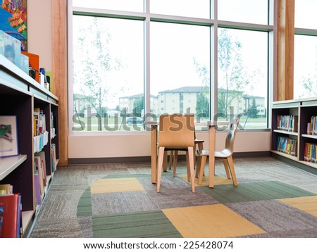 Interior of library with bookshelves and seating arrangement - stock photo