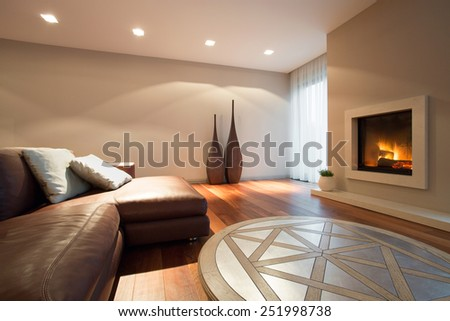 Interior of living room with a fireplace - stock photo