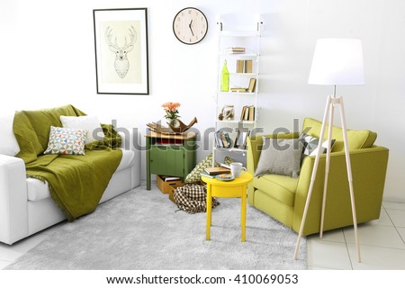 Interior of living room with couch and armchair