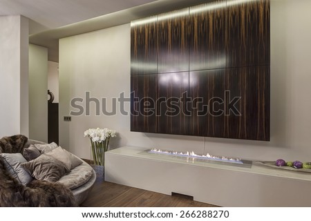 Interior of luxury kitchen with round table and a view of the fireplace - stock photo