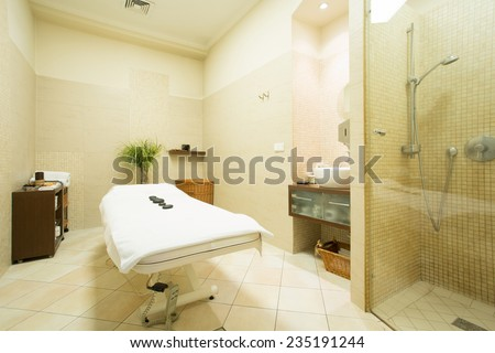 Interior of massage room in wellness center - stock photo