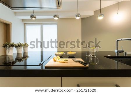 Interior of modern and shiny kitchen - stock photo