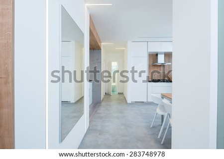 interior of modern apartment - hallway leading to the kitchen and bathroom - stock photo