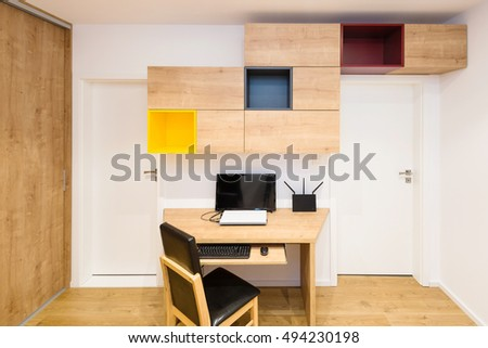 interior of modern apartment with computer table