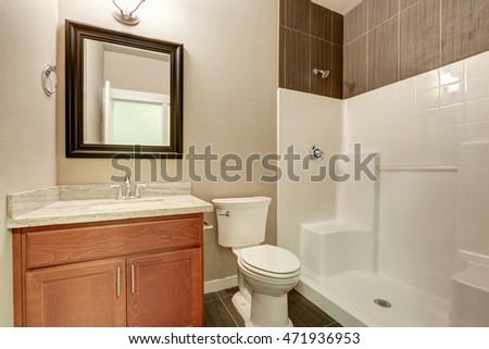 Interior of modern bathroom. Bathroom Vanity cabinet with marble top. Northwest, USA