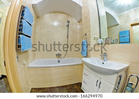 Interior of modern bathroom with mirror