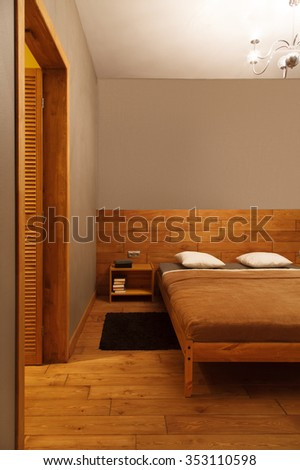 Interior of modern bedroom in a minimalist style with artificial light - stock photo