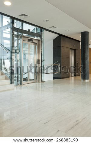 Interior of modern business building having elevator - stock photo