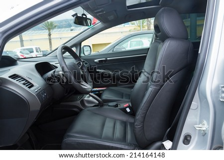 interior of modern car with leather black front seats