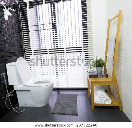 Interior of modern contemporary bathroom with toilet - stock photo