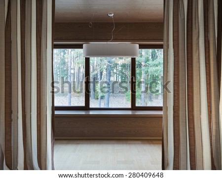 Interior of modern empty room with big windows