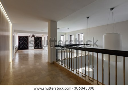 Interior of modern empty space with closet, handrail and windows - stock photo