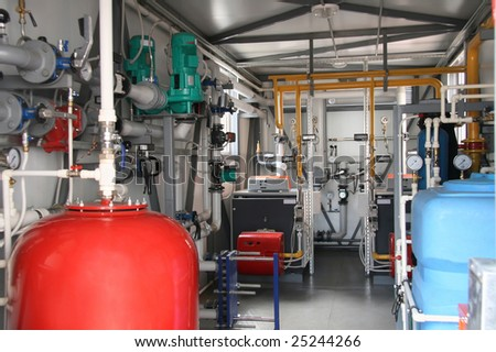 Interior of modern gas boiler-house with two boilers - stock photo