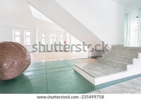 Interior of modern home with big stone inside - stock photo