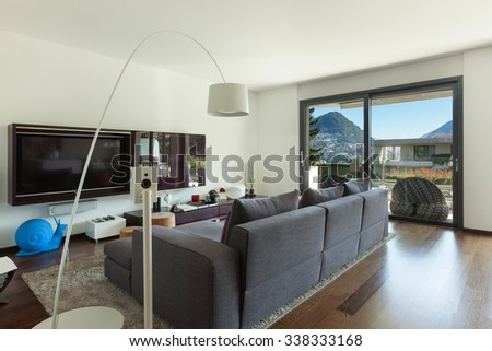Interior of modern house, living room with comfortable divan - stock photo