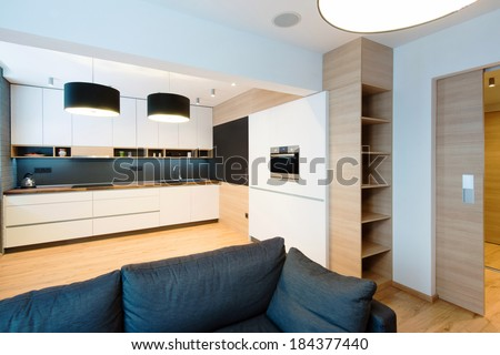 interior of modern kitchen connected with living room - stock photo