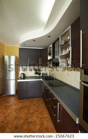 Interior of modern kitchen in dark colour - stock photo