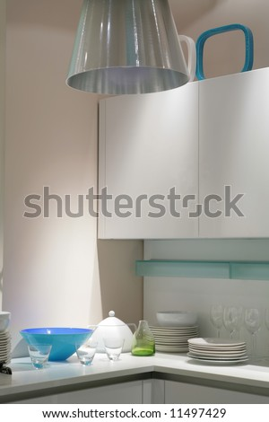 interior of modern kitchen in light tone with blue tureen