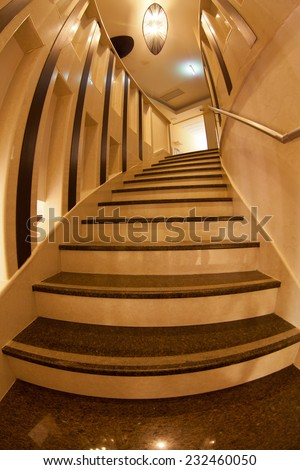 interior of modern marble stairs taken with fisheye lens - stock photo