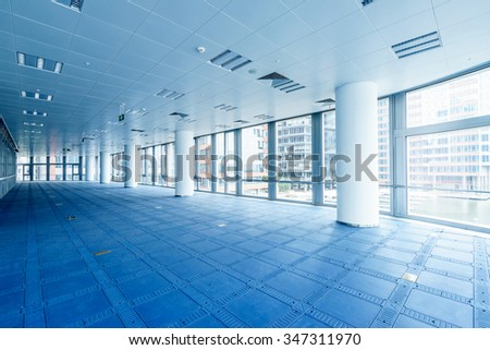 interior of modern office building and outside scene through window