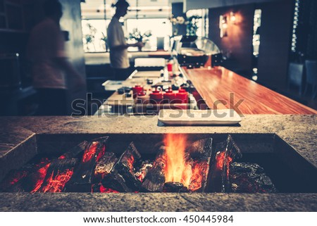 Interior of modern restaurant with fireplace close-up - stock photo