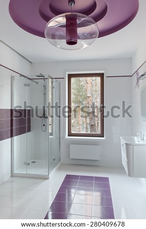 Interior of modern restroom with shower in pink colors - stock photo