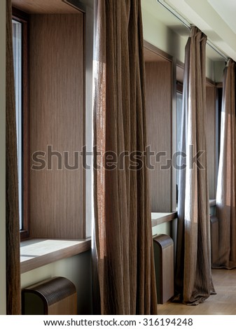 Interior of modern room with windows and curtains - stock photo