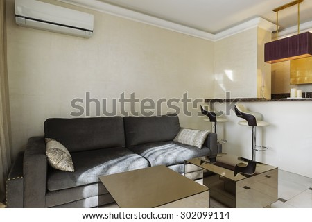 Interior of modern studio apartment with golden details - stock photo