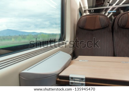 interior of modern train with seat and window - stock photo