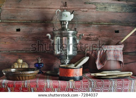 interior of  museum of traditional russian wood hut with samovar