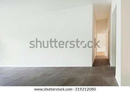 interior of new apartment, empty living room, tiled floor - stock photo