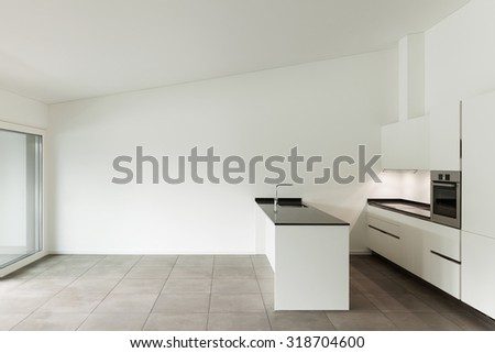 interior of new apartment, white domestic kitchen - stock photo