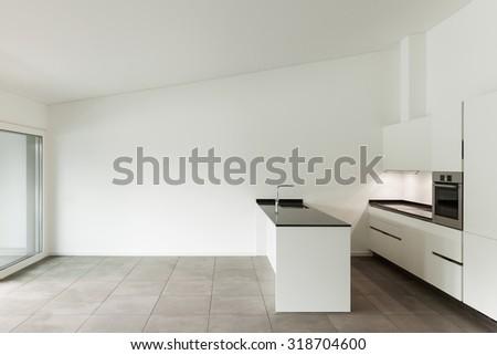 interior of new apartment, white domestic kitchen - stock photo