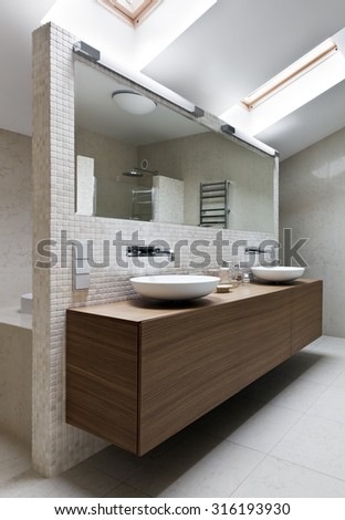 Interior of new modern bathroom in daylight - stock photo