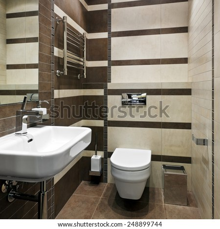 Interior of new modern restroom - stock photo