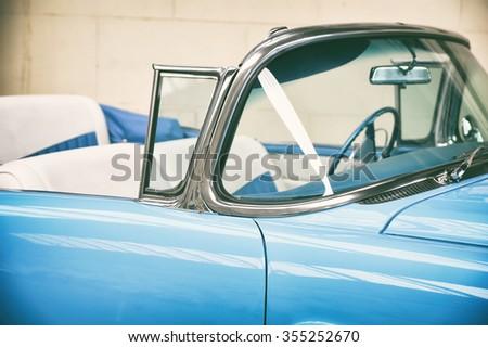 Interior of old car close-up. Retro toned photo - stock photo