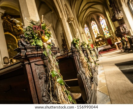 Interior of old church with harvest decorations.Stein (Krems an der Donau) in Lower Austria - stock photo