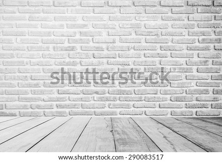 interior of old white brick wall with old white wooden floor.