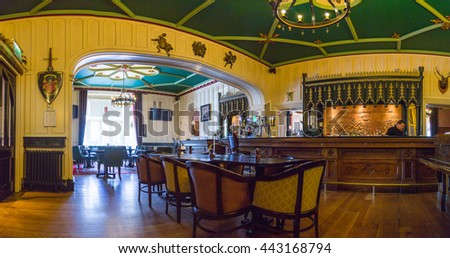 Interior of pub, for drinking and socializing, focal point of community. Gorgeous pub bar interior - stock photo