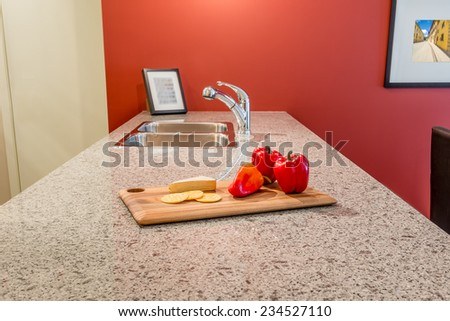 interior of red dining room and kitchen with red pepper on the table