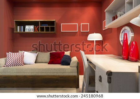 Interior of red student (teenager) room - back to school - stock photo