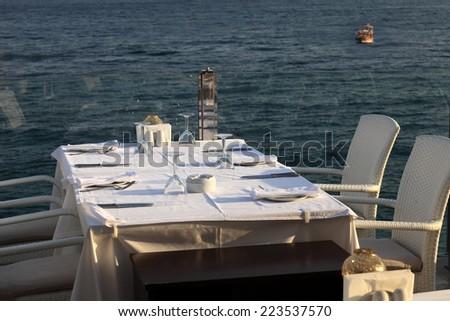 Interior of restaurant overlooking the sea, Turkey - stock photo
