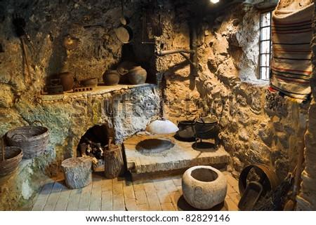 Interior of retro room in cave, Croatia - stock photo