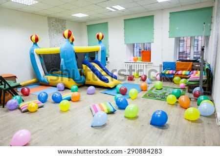 Interior of room with inflatable trampoline for children birthday or party