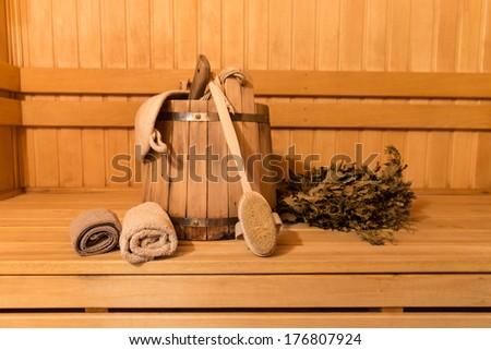 Interior of sauna and sauna accessories - stock photo