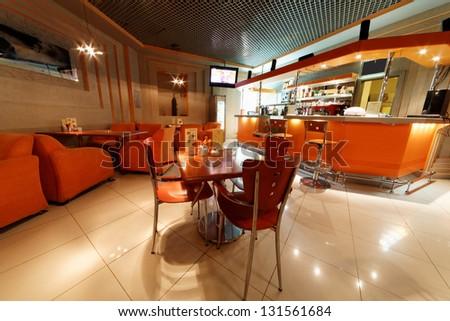 Interior of small cafe-bar in orange tones - stock photo
