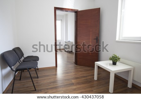 Interior of small empty doctor's consulting room and waiting room without people. - stock photo