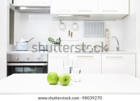 interior of small white kitchen with fresh apples on the table