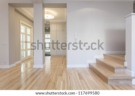 Interior of stylish house: corridor, entry, staircase - stock photo