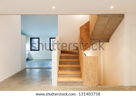 Interior of stylish modern house, staircase view - stock photo